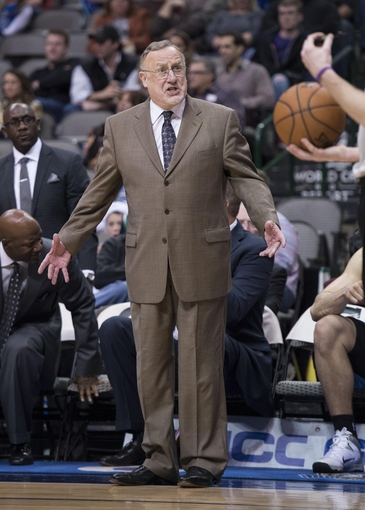 Nov 30, 2013; Dallas, TX, USA; Minnesota Timberwolves head coach Rick Adelman argues a call with the referee during the second half against the Dallas Mavericks at the American Airlines Center. The Timberwolves defeated the Mavericks 112-106. Mandatory Credit: Jerome Miron-USA TODAY Sports