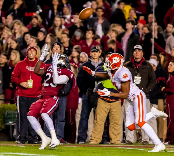 Nov 30, 2013; Columbia, SC, USA; South Carolina Gamecocks wide receiver Bruce Ellington (23) makes a reception as Clemson Tigers safety Korrin Wiggins (12) covers in the second quarter at Williams-Brice Stadium. Mandatory Credit: Jeff Blake-USA TODAY Sports