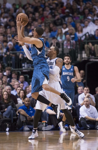 Nov 30, 2013; Dallas, TX, USA; Minnesota Timberwolves shooting guard Kevin Martin (23) makes a jump shot in front of Dallas Mavericks small forward Shawn Marion (0) during the second half at the American Airlines Center. The Timberwolves defeated the Mavericks 112-106. Mandatory Credit: Jerome Miron-USA TODAY Sports