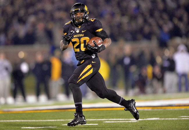 Nov 30, 2013; Columbia, MO, USA; Missouri Tigers running back Henry Josey (20) rushes 57-yards for a touchdown against the Texas A&M Aggies during the second half at Faurot Field. Missouri defeated Texas A&M 28-21. Mandatory Credit: Peter G. Aiken-USA TODAY Sports