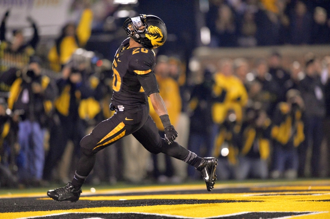 Nov 30, 2013; Columbia, MO, USA; Missouri Tigers running back Henry Josey (20) celebrates after rushing 57-yards for a touchdown against the Texas A&M Aggies during the second half at Faurot Field. Missouri defeated Texas A&M 28-21. Mandatory Credit: Peter G. Aiken-USA TODAY Sports