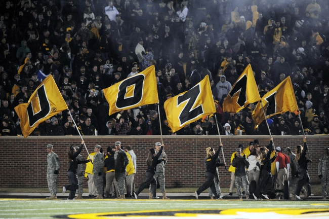 Nov 30, 2013; Columbia, MO, USA; Missouri Tigers cheerleaders wave flags after a score during the second half of the game against the Texas A&M Aggies at Faurot Field. Missouri win 28-21. Mandatory Credit: Denny Medley-USA TODAY Sports