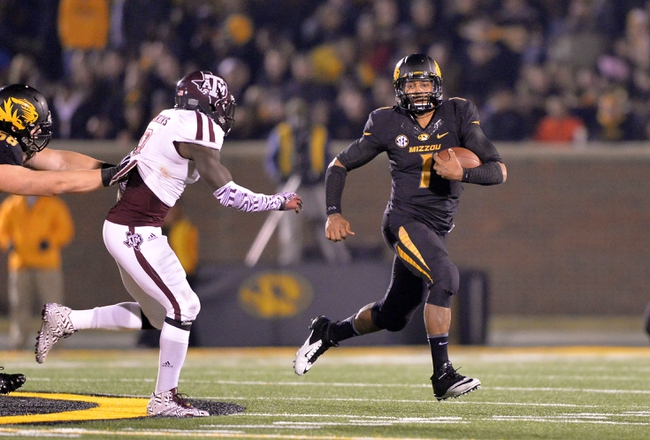 Nov 30, 2013; Columbia, MO, USA; Missouri Tigers quarterback James Franklin (1) rushes up field against the Texas A&M Aggies during the second half at Faurot Field. Missouri defeated Texas A&M 28-21. Mandatory Credit: Peter G. Aiken-USA TODAY Sports