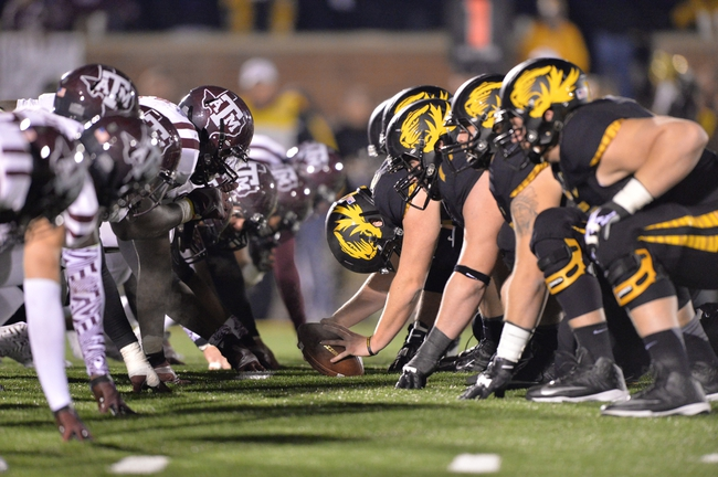 Nov 30, 2013; Columbia, MO, USA; The Missouri Tigers get set to snap the ball against the Texas A&M Aggies during the second half at Faurot Field. Missouri defeated Texas A&M 28-21. Mandatory Credit: Peter G. Aiken-USA TODAY Sports