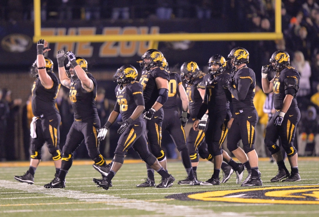 Nov 30, 2013; Columbia, MO, USA; The Missouri Tigers celebrate as they defeat the Texas A&M Aggies 28-21 at Faurot Field. Mandatory Credit: Peter G. Aiken-USA TODAY Sports