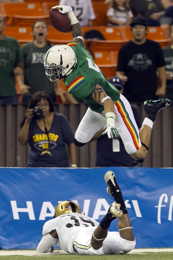 Nov 30, 2013; Honolulu, HI, USA; Hawaii Warriors wide receiver Billy Ray Stutzmann (5) leaps over Army Black Knights defensive back Josh Jenkins (39) during the first quarter at Aloha Stadium. Mandatory Credit: Marco Garcia-USA TODAY Sports