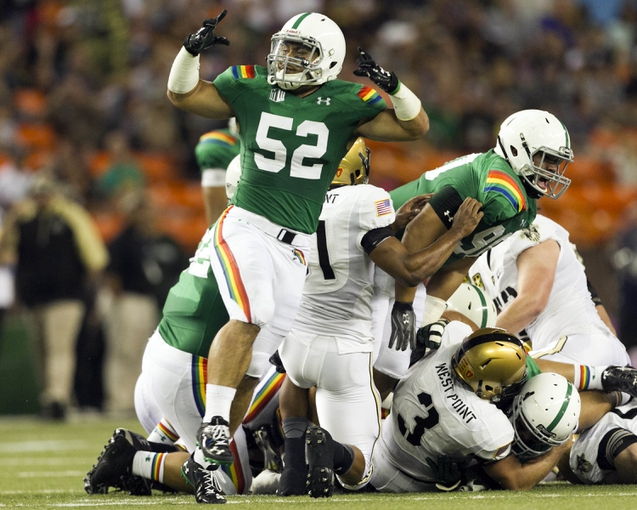 Nov 30, 2013; Honolulu, HI, USA; Hawaii Warriors linebacker Tevita Lataimua (52) celebrates after the Hawaii defense stopped an Army Black Knights fourth down play during the first quarter at Aloha Stadium. Mandatory Credit: Marco Garcia-USA TODAY Sports