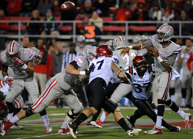 Nov 30, 2013; Las Vegas, NV, USA; UNLV Rebels quarterback Caleb Herring (8) delivers a pass against the San Diego State Aztecs during an NCAA football game at Sam Boyd Stadium. Mandatory Credit: Stephen R. Sylvanie-USA TODAY Sports