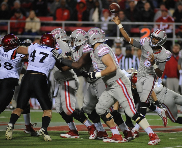 Nov 30, 2013; Las Vegas, NV, USA; UNLV Rebels quarterback Caleb Herring (8) makes a pass attempt against the San Diego State Aztecs during an NCAA football game at Sam Boyd Stadium. Mandatory Credit: Stephen R. Sylvanie-USA TODAY Sports