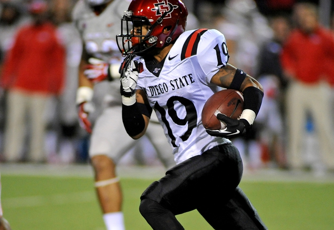 Nov 30, 2013; Las Vegas, NV, USA; San Diego State Aztecs running back Donnel Pumphrey (19) carries the ball against the UNLV Rebels during an NCAA football game at Sam Boyd Stadium. Mandatory Credit: Stephen R. Sylvanie-USA TODAY Sports