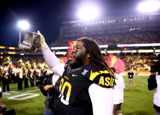 Nov 30, 2013; Tempe, AZ, USA; Arizona State Sun Devils defensive tackle Will Sutton celebrates with the trophy after defeating the Arizona Wildcats in the 87th annual Territorial Cup at Sun Devil Stadium. Arizona State defeated Arizona 58-21. Mandatory Credit: Mark J. Rebilas-USA TODAY Sports