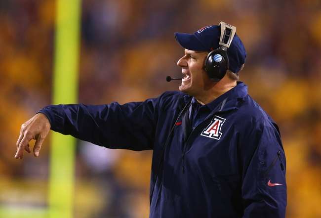 Nov 30, 2013; Tempe, AZ, USA; Arizona Wildcats head coach Rich Rodriguez reacts in the second half against the Arizona State Sun Devils in the 87th annual Territorial Cup at Sun Devil Stadium. Arizona State defeated Arizona 58-21. Mandatory Credit: Mark J. Rebilas-USA TODAY Sports