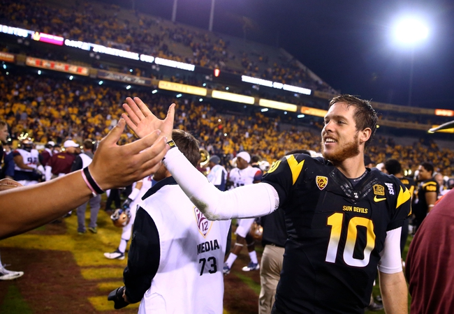 Nov 30, 2013; Tempe, AZ, USA; Arizona State Sun Devils quarterback Taylor Kelly celebrates following the game against the Arizona Wildcats in the 87th annual Territorial Cup at Sun Devil Stadium. Arizona State defeated Arizona 58-21. Mandatory Credit: Mark J. Rebilas-USA TODAY Sports