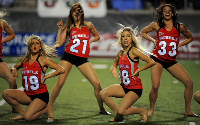 Nov 30, 2013; Las Vegas, NV, USA; UNLV Rebels cheerleaders entertain the crowd during a stoppage in play between the Rebels and the San Diego State Aztecs at Sam Boyd Stadium. UNLV won the game 45-19. Mandatory Credit: Stephen R. Sylvanie-USA TODAY Sports