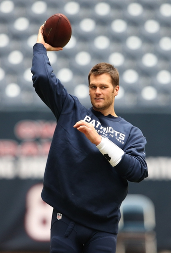 Dec 1, 2013; Houston, TX, USA; New England Patriots quarterback Tom Brady (12) throws prior to the game against the Houston Texans at Reliant Stadium. Mandatory Credit: Matthew Emmons-USA TODAY Sports