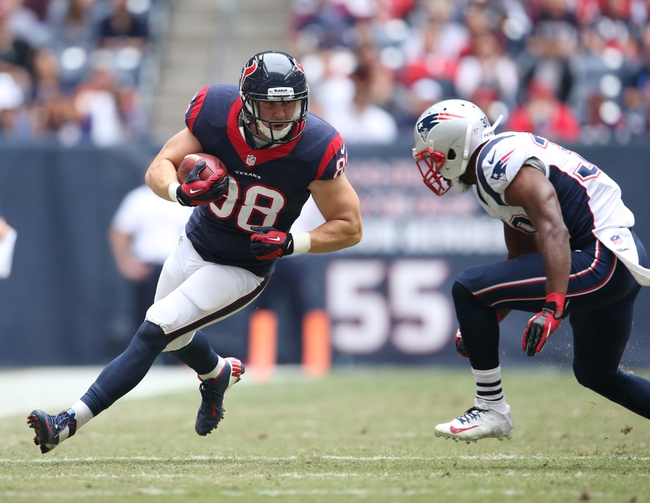 Dec 1, 2013; Houston, TX, USA; Houston Texans tight end Garrett Graham (88) runs after a reception against New England Patriots safety Duron Harmon (30) at Reliant Stadium. Mandatory Credit: Matthew Emmons-USA TODAY Sports