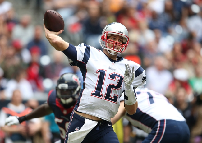 Dec 1, 2013; Houston, TX, USA; New England Patriots quarterback Tom Brady (12) throws in the pocket in the second quarter against the Houston Texans at Reliant Stadium. Mandatory Credit: Matthew Emmons-USA TODAY Sports