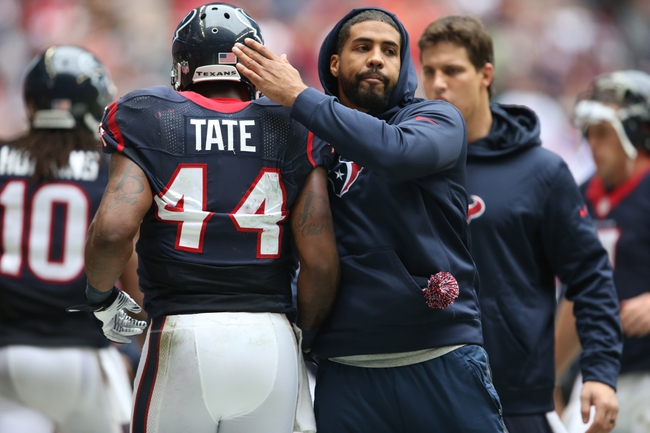 Dec 1, 2013; Houston, TX, USA; Houston Texans running back Ben Tate (44) celebrates with injured running back Arian Foster in the second quarter against the New England Patriots at Reliant Stadium. Mandatory Credit: Matthew Emmons-USA TODAY Sports