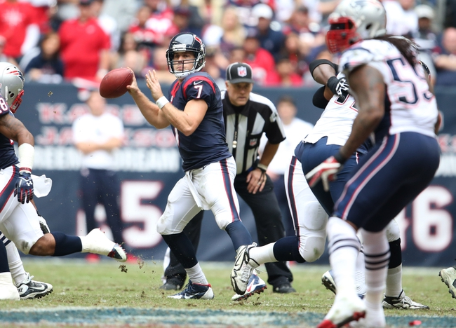 Dec 1, 2013; Houston, TX, USA; Houston Texans quarterback Case Keenum (7) throws in the pocket against the New England Patriots at Reliant Stadium. Mandatory Credit: Matthew Emmons-USA TODAY Sports