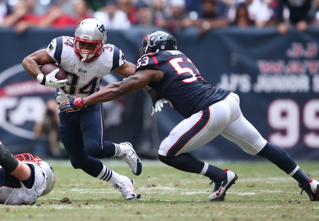 Dec 1, 2013; Houston, TX, USA; New England Patriots running back Shane Vereen (34) runs with the ball against Houston Texans linebacker Joe Mays (53) in the second quarter at Reliant Stadium. Mandatory Credit: Matthew Emmons-USA TODAY Sports