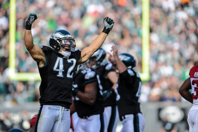 Dec 1, 2013; Philadelphia, PA, USA;  Philadelphia Eagles free safety Kurt Coleman (42) celebrates a turnover during the first quarter against the Arizona Cardinals at Lincoln Financial Field. Mandatory Credit: John Geliebter-USA TODAY Sports