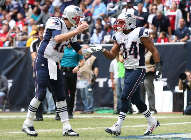 Dec 1, 2013; Houston, TX, USA; New England Patriots running back Shane Vereen (34) celebrates his third quarter touchdown with quarterback Tom Brady (12) against the Houston Texans at Reliant Stadium. Mandatory Credit: Matthew Emmons-USA TODAY Sports