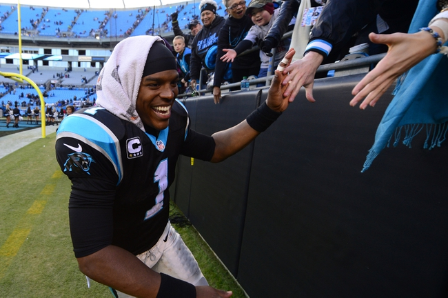 Dec 1, 2013; Charlotte, NC, USA; Carolina Panthers quarterback Cam Newton (1) reacts with fans after the game. The Carolina Panthers defeated the Tampa Bay Buccaneers 27-6 at Bank of America Stadium. Mandatory Credit: Bob Donnan-USA TODAY Sports