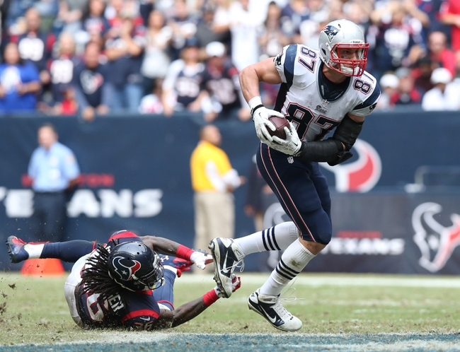 Dec 1, 2013; Houston, TX, USA; New England Patriots tight end Rob Gronkowski (87) runs after a reception against Houston Texans safety D.J. Swearinger (36) in the fourth quarter at Reliant Stadium. The Patriots beat the Texans 34-31. Mandatory Credit: Matthew Emmons-USA TODAY Sports