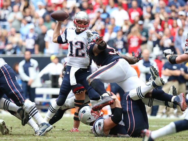 Dec 1, 2013; Houston, TX, USA; New England Patriots quarterback Tom Brady (12) throws in the pocket in the fourth quarter against the Houston Texans at Reliant Stadium. The Patriots beat the Texans 34-31. Mandatory Credit: Matthew Emmons-USA TODAY Sports