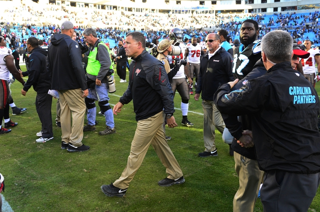 Dec 1, 2013; Charlotte, NC, USA; Tampa Bay Buccaneers head coach Greg Schiano walks off the field after the game. The Carolina Panthers defeated the Tampa Bay Buccaneers 27-6 at Bank of America Stadium. Mandatory Credit: Bob Donnan-USA TODAY Sports