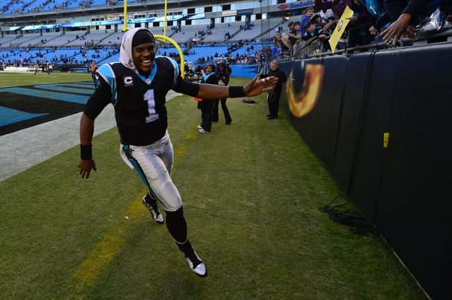 Dec 1, 2013; Charlotte, NC, USA; Carolina Panthers quarterback Cam Newton (1) runs off the field after the game. The Carolina Panthers defeated the Tampa Bay Buccaneers 27-6 at Bank of America Stadium. Mandatory Credit: Bob Donnan-USA TODAY Sports