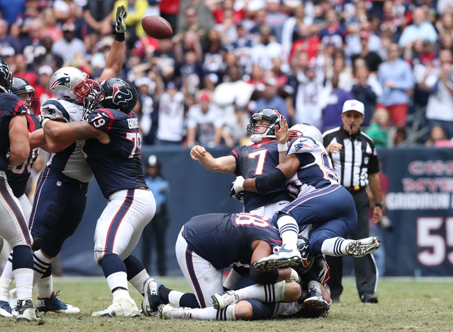 Dec 1, 2013; Houston, TX, USA; Houston Texans quarterback Case Keenum (7) is hit as he throws late in the fourth quarter by New England Patriots defensive end Andre Carter (96) and Rob Ninkovich (50) at Reliant Stadium. The Patriots beat the Texans 34-31.Mandatory Credit: Matthew Emmons-USA TODAY Sports