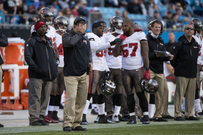 Dec 1, 2013; Charlotte, NC, USA; Tampa Bay Buccaneers head coach Greg Schiano reacts in the fourth quarter. The Carolina Panthers defeated the Tampa Bay Buccaneers 27-6 at Bank of America Stadium. Mandatory Credit: Bob Donnan-USA TODAY Sports