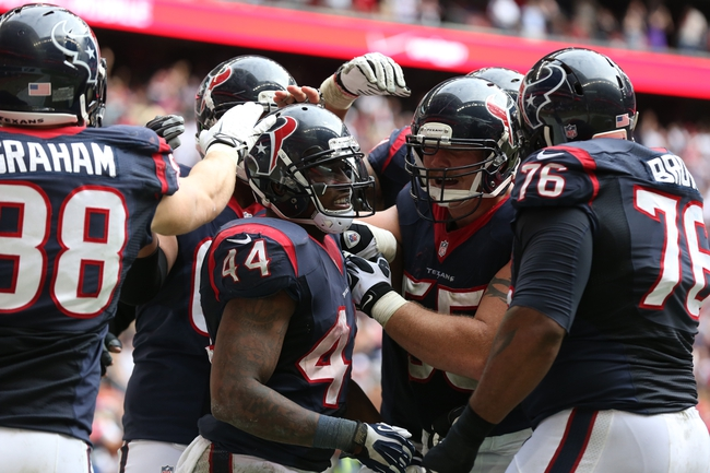 Dec 1, 2013; Houston, TX, USA; Houston Texans running back Ben Tate (44) celebrates his fourth quarter touchdown with teammates against the New England Patriots at Reliant Stadium. The Patriots beat the Texans 34-31. Mandatory Credit: Matthew Emmons-USA TODAY Sports