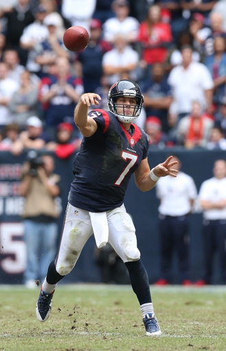 Dec 1, 2013; Houston, TX, USA; Houston Texans quarterback Case Keenum (7) throws in the pocket against the New England Patriots at Reliant Stadium. The Patriots beat the Texans 34-31. Mandatory Credit: Matthew Emmons-USA TODAY Sports