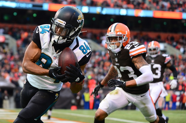 Dec 1, 2013; Cleveland, OH, USA; Jacksonville Jaguars wide receiver Cecil Shorts (84) catches the game winning pass in the end zone while being defended by Cleveland Browns cornerback Joe Haden (23) in the fourth quarter at FirstEnergy Stadium. Mandatory Credit: Andrew Weber-USA TODAY Sports