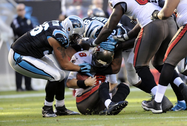 Dec 1, 2013; Charlotte, NC, USA; Tampa Bay Buccaneers quarterback Mike Glennon (8) gets sacked by Carolina Panthers defensive end Wes Horton (96) during the second half of the game at Bank of America Stadium. Carolina wins 27-6. Mandatory Credit: Sam Sharpe-USA TODAY Sports