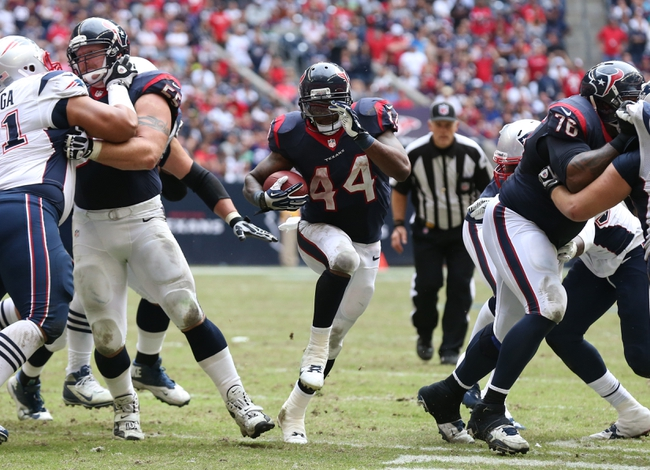 Dec 1, 2013; Houston, TX, USA; Houston Texans running back Ben Tate (44) runs with the ball for a fourth quarter touchdown against the New England Patriots at Reliant Stadium. The Patriots beat the Texans 34-31. Mandatory Credit: Matthew Emmons-USA TODAY Sports
