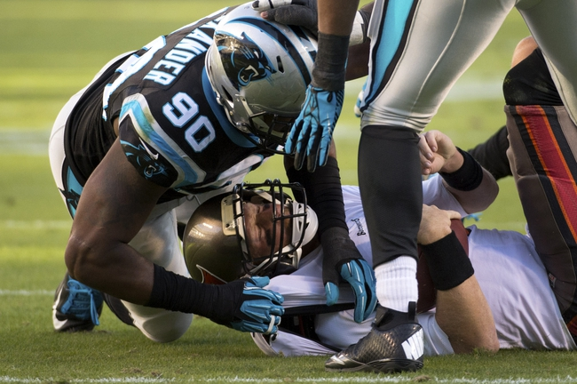 Dec 1, 2013; Charlotte, NC, USA; Carolina Panthers defensive ends Frank Alexander (90) and Wes Horton (96) sack Tampa Bay Buccaneers quarterback Mike Glennon (8) in the fourth quarter. The Carolina Panthers defeated the Tampa Bay Buccaneers 27-6 at Bank of America Stadium. Mandatory Credit: Bob Donnan-USA TODAY Sports