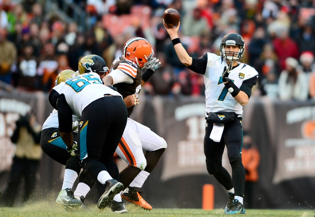Dec 1, 2013; Cleveland, OH, USA; Jacksonville Jaguars quarterback Chad Henne (7) throws a pass in the fourth quarter against the Cleveland Browns at FirstEnergy Stadium. Mandatory Credit: Andrew Weber-USA TODAY Sports