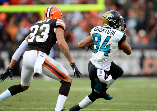Dec 1, 2013; Cleveland, OH, USA; Jacksonville Jaguars wide receiver Cecil Shorts (84) looks to get around Cleveland Browns cornerback Joe Haden (23) in the fourth quarter at FirstEnergy Stadium. Mandatory Credit: Andrew Weber-USA TODAY Sports