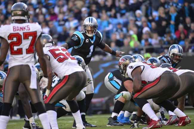 Dec 1, 2013; Charlotte, NC, USA; Carolina Panthers quarterback Cam Newton (1) calls signals in the fourth quarter. The Carolina Panthers defeated the Tampa Bay Buccaneers 27-6 at Bank of America Stadium. Mandatory Credit: Bob Donnan-USA TODAY Sports