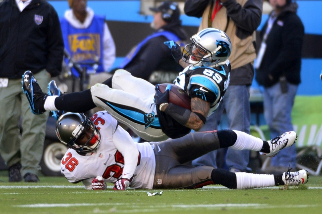 Dec 1, 2013; Charlotte, NC, USA; Carolina Panthers wide receiver Steve Smith (89) is tackled by Tampa Bay Buccaneers cornerback Danny Gorrer (36) in the fourth quarter. The Carolina Panthers defeated the Tampa Bay Buccaneers 27-6 at Bank of America Stadium. Mandatory Credit: Bob Donnan-USA TODAY Sports