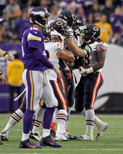 Dec 1, 2013; Minneapolis, MN, USA; Chicago Bears linebacker Khaseem Greene (59) celebrates his interception with teammates during the fourth quarter against the Minnesota Vikings at Mall of America Field at H.H.H. Metrodome. The Vikings defeated the Bears 23-20 in overtime. Mandatory Credit: Brace Hemmelgarn-USA TODAY Sports
