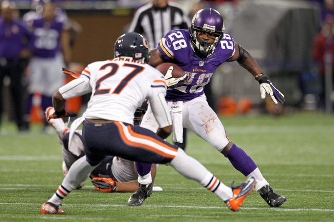 Dec 1, 2013; Minneapolis, MN, USA; Minnesota Vikings running back Adrian Peterson (28) carries the ball during overtime against the Chicago Bears at Mall of America Field at H.H.H. Metrodome. The Vikings defeated the Bears 23-20 in overtime. Mandatory Credit: Brace Hemmelgarn-USA TODAY Sports