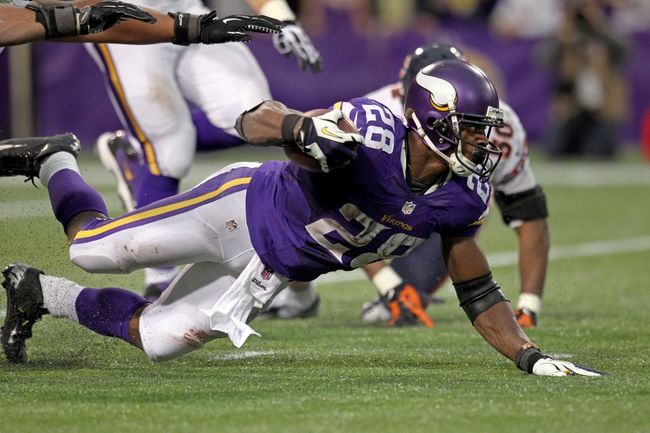Dec 1, 2013; Minneapolis, MN, USA; Minnesota Vikings running back Adrian Peterson (28) dives during the fourth quarter against the Chicago Bears at Mall of America Field at H.H.H. Metrodome. The Vikings defeated the Bears 23-20 in overtime. Mandatory Credit: Brace Hemmelgarn-USA TODAY Sports