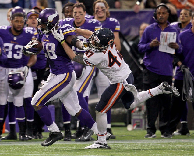 Dec 1, 2013; Minneapolis, MN, USA; Minnesota Vikings running back Adrian Peterson (28) breaks a tackle from Chicago Bears safety Chris Conte (47) during overtime at Mall of America Field at H.H.H. Metrodome. The Vikings defeated the Bears 23-20 in overtime. Mandatory Credit: Brace Hemmelgarn-USA TODAY Sports
