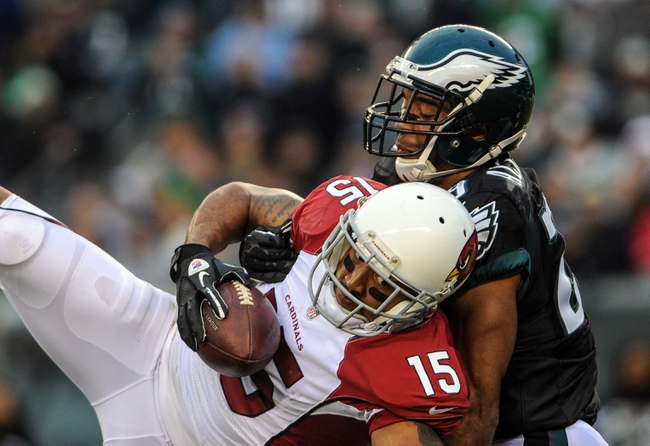 Dec 1, 2013; Philadelphia, PA, USA;  Arizona Cardinals wide receiver Michael Floyd (15) catches a pass as Philadelphia Eagles strong safety Nate Allen (29) defends the game at Lincoln Financial Field. The Philadelphia Eagles won the game 24-21.  Mandatory Credit: John Geliebter-USA TODAY Sports