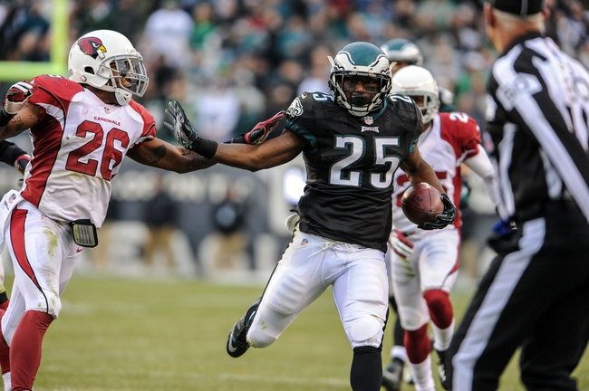 Dec 1, 2013; Philadelphia, PA, USA;  Philadelphia Eagles running back LeSean McCoy (25) is pushed out of bounds by Arizona Cardinals free safety Rashad Johnson (26) during the game at Lincoln Financial Field. The Philadelphia Eagles won the game 24-21.  Mandatory Credit: John Geliebter-USA TODAY Sports