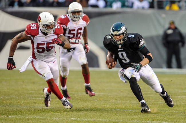 Dec 1, 2013; Philadelphia, PA, USA;  Philadelphia Eagles quarterback Nick Foles (9) scrambles as Arizona Cardinals outside linebacker John Abraham (55) chases him during the game at Lincoln Financial Field. The Philadelphia Eagles won the game 24-21.  Mandatory Credit: John Geliebter-USA TODAY Sports